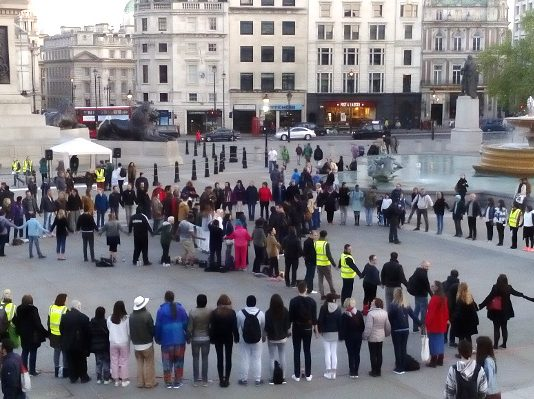 Living peace sign at Trafalgar Square - London