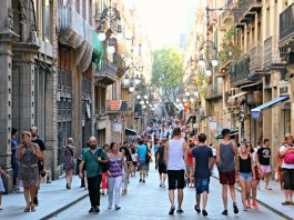 Tourists in Barcelona Gothic quarter.