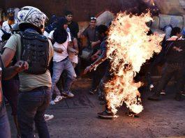 Chavista allegedly by Guarimberos.