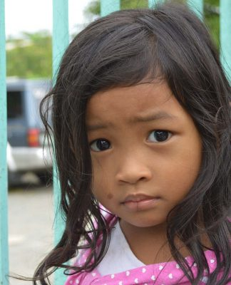 Sad Filipino girl. Photo by: Gonzales Earnest.