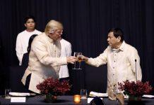 U.S. President Donald Trump toasts with Philippines President Rodrigo Duterte during the gala dinner marking ASEAN's 50th anniversary in Manila, Philippines November 12, 2017. REUTERS/Jonathan Ernst