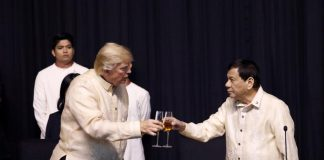U.S. President Donald Trump toasts with Philippines President Rodrigo Duterte during the gala dinner marking ASEAN's 50th anniversary in Manila, Philippines November 12, 2017. REUTERS/Jonathan Ernst