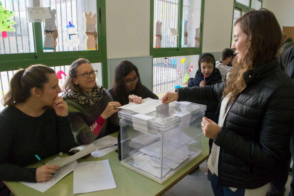 Woman at the ballot box. Photo by: Evan McCaffrey.