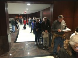 Hundreds of people in line at the Fairfax Govt Center. Photo by: Neal Augenstein.