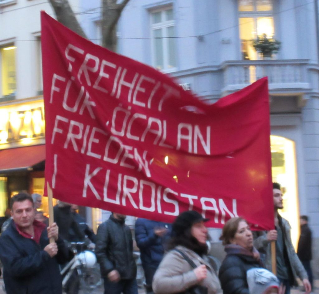 Kurdish protest in Freiburg, Germany. The poster reads 'Freedom for Öcalan, peace in Kurdistan'. It refers to Abdullah Öcalan, who is a Kurdish nationalist leader and one of the founders of the PKK. Photo by: Joshua Stein.