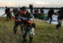 Peruvian Marines conduct a beach assault during field training along the Amazon River. Photo by: U.S. Navy photo by Chief Journalist Dave Fliesen.
