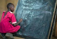 Masai girl at school doing maths (Kenya). Photo by: Christopher Michel