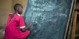 Masai girl at school doing maths (Kenya). Photo by: Christopher Michel