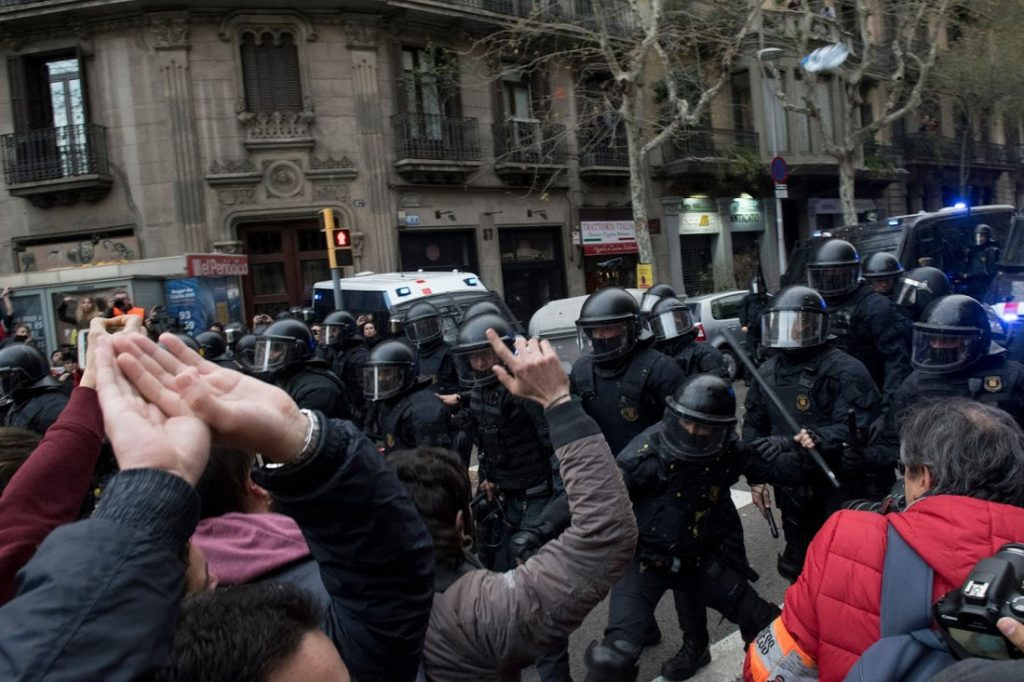 Protestors clash with the riot police in Barcelona. Photo by: Evan McCaffrey.