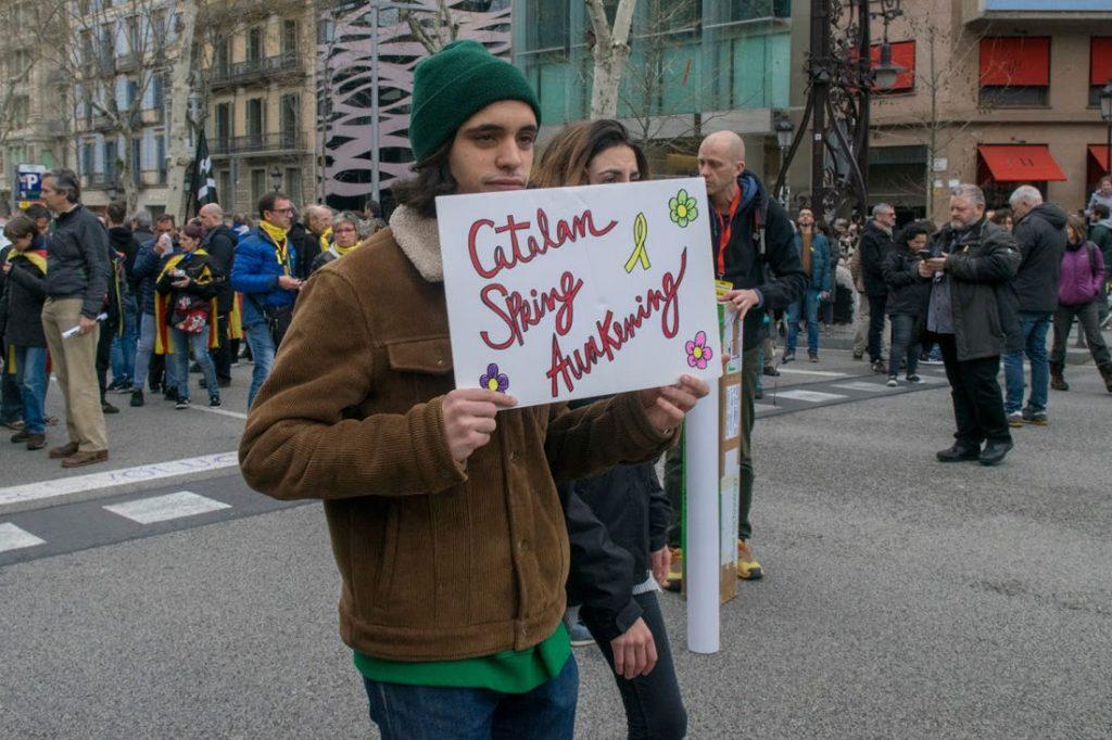 "Pro-Independence protestors. Sign reads ""Catalan Spring Awakening"". Photo by: Evan McCaffrey."