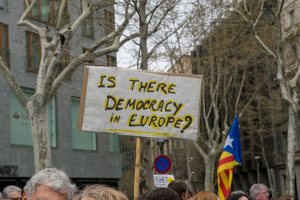 "Pro-Independence protestors. Sign reads ""Is there democracy in Europe?"". Photo by: Evan McCaffrey."