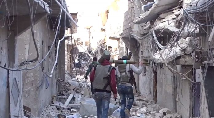 Syrian rebels carry RPG-29 anti-tank missiles Damascus, Syria. Photo by: Qasioun News Agency.