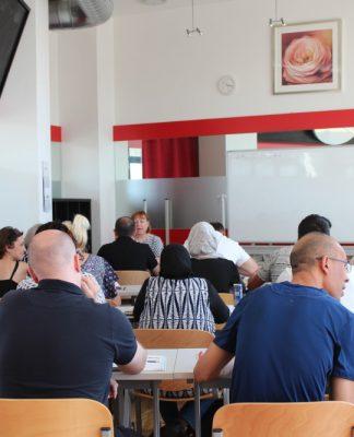 Khaleel Mustafa and Omer Azizi in their German language class. Photo by: Daniyal Daud.