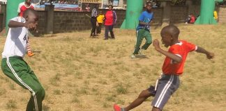 John Nyanganyi (left) attempts to dribble past Cosmas Asunga during Sports Day at Moi Avenue Primary School on Wednesday. Photo by: Ronnie Evans.