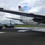 Birmingham Airport fire trucks sprayed the plane to prevent fire. Photo by: Via News.