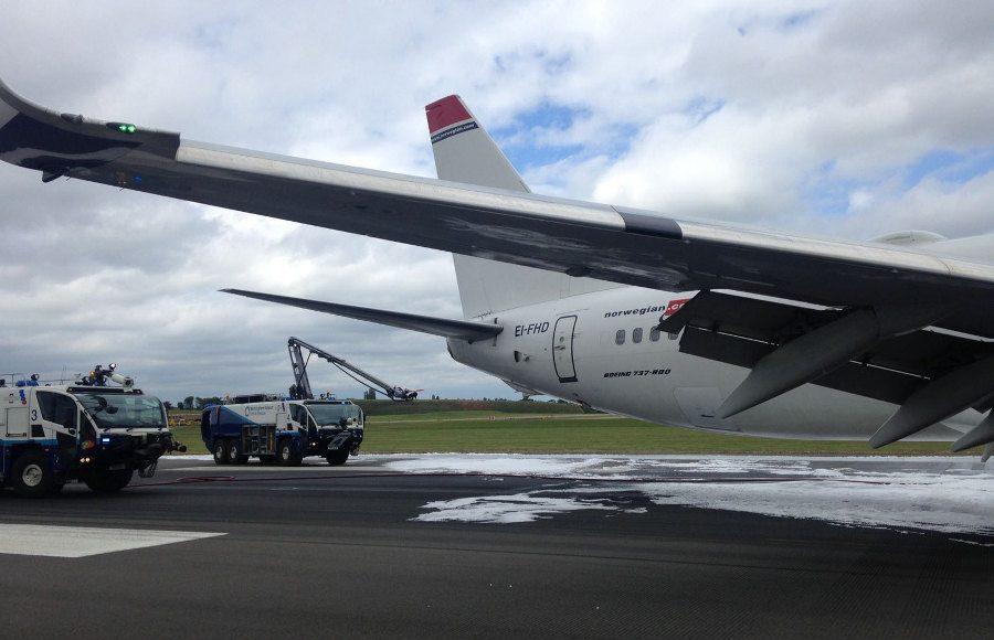 Birmingham Airport fire trucks sprayed the plane to prevent fire. Photo by: Via News.