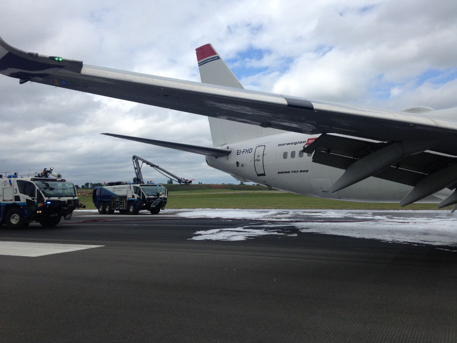Birmingham Airport fire trucks sprayed the airplane to prevent fire. Photo by: Via News.