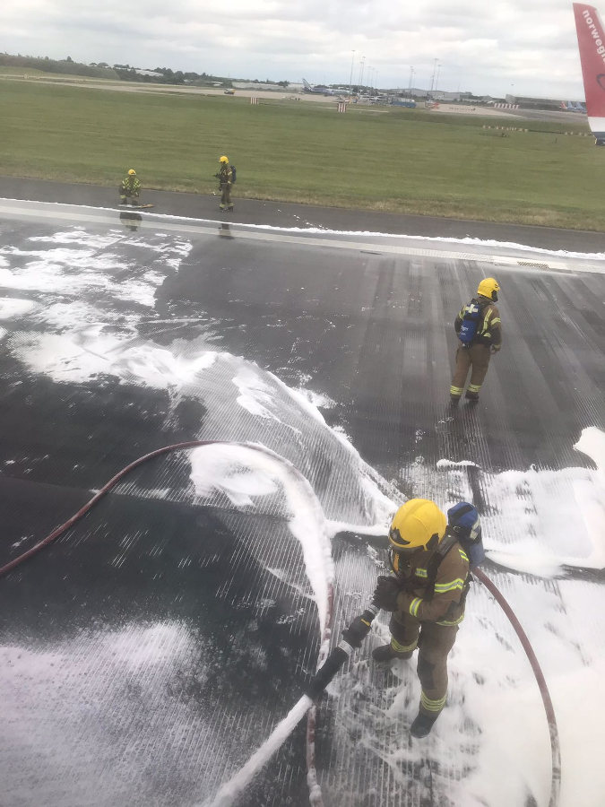 Inside passenger view of the D86241 Norwegian Air airplane while anti-fire foam is sprayed. Photo by: Via News.