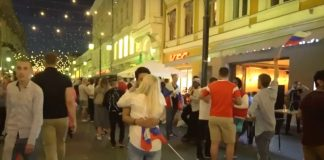 Russia World Cup fan kissing Russian girl.