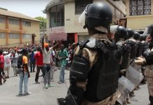 Haiti unrest: Protesters pillaged stores, torched cars.