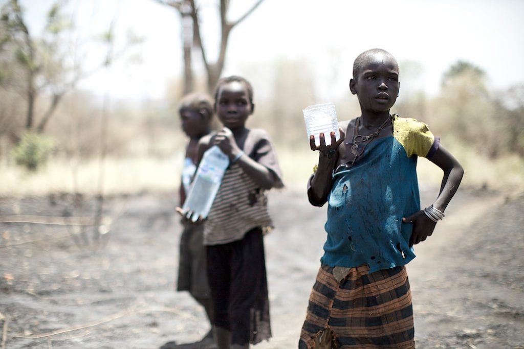 South Sudan girls collected water from a recently opened borehole. Water that, if contaminated, may pose a serious health threat. Photo by: Arsenie Coseac.