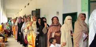 Women from Rawalpindi queued to vote for Pakistan's elections. Photo by: Rachel Clayton/Department for International Development.