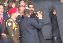 President Maduro being secured by government staff moments after the first drone exploded.