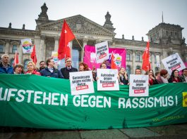 "Protest against the AfD in the Bundestag. The sign reads ""Stand up against racism"". Photo by: Martin Heinlein."