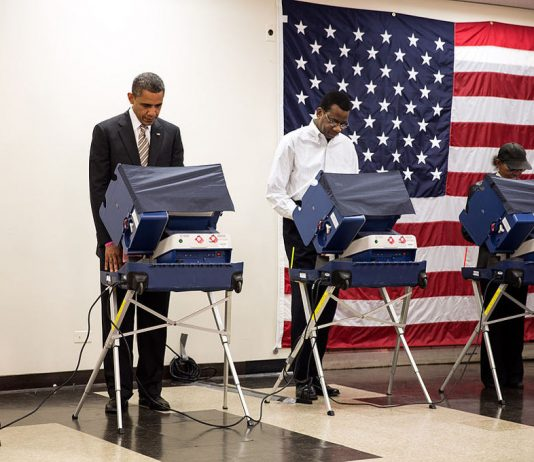 United States President, Barack Obama, casts his ballot in the 2012 U.S. election at the Martin Luther King Jr. Community Center in Chicago, Illinois. Photo by: Pete Souza.