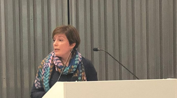 """Amalia Ribi Forclaz at the Graduate Institute Geneva talk about """"Crisis and conflict in Agriculture"""". Photo by Kimberley Evans."""