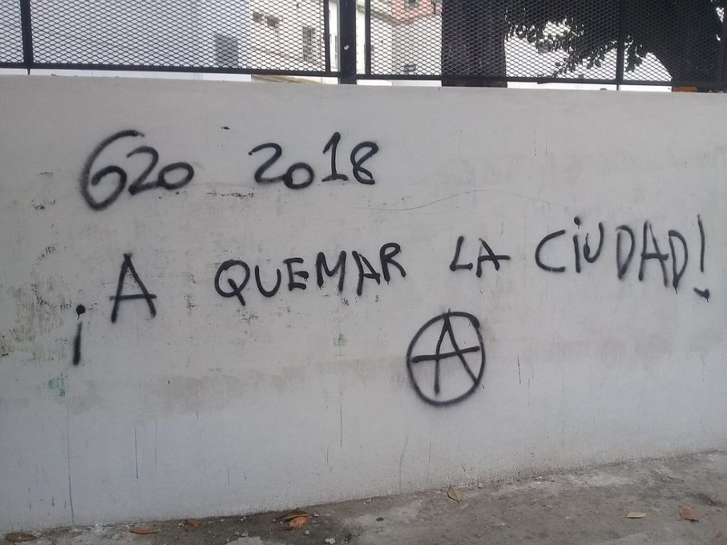 """G20 2018 - Burn the city"" Graffiti on a wall in Buenos Aires, made in the days leading up to the G20 summit in Argentina. Photo by Cambalachero."