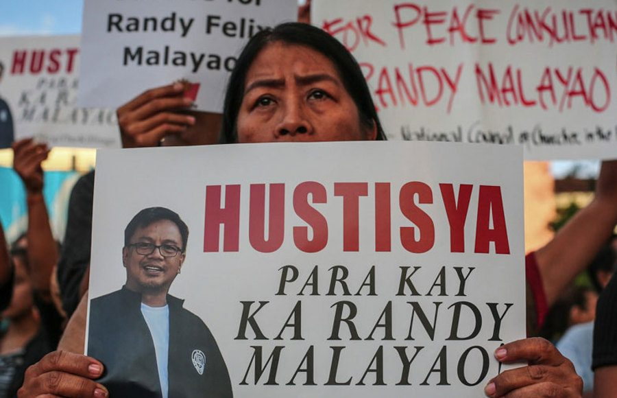 Activists protesting against the killing of Randy Malayao. Photo by: ABS-CBN.