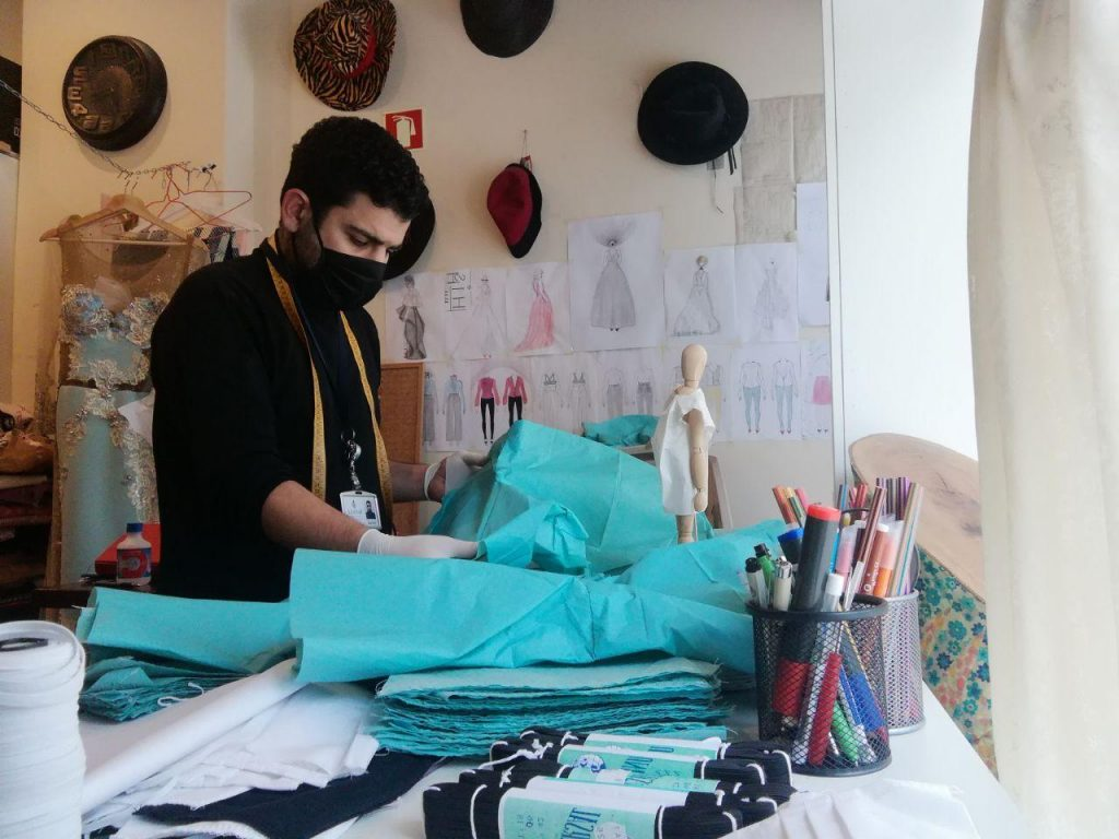 Ismail has been making protective covers for healthcare professionals caring for COVID-19 patients at Hospital de Dona Estefânia. (Photo credit: Casa de Moda Boali)